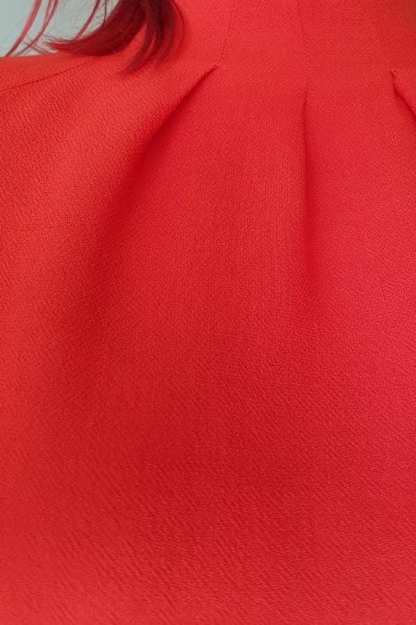 Raudonai oranzines spalvos palaidines audinys